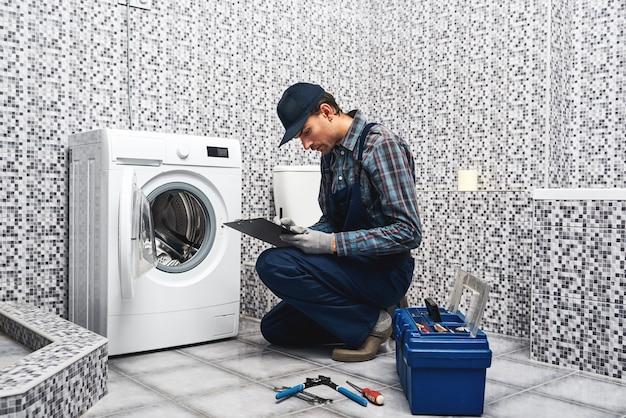 Price of plumbers work working man plumber writing price list