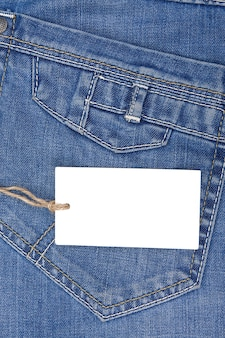 Price tag over blue jeans textured pocket