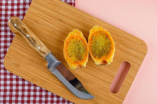 Prickly pear with kinfe on cutting board