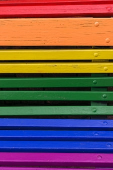 Pride day concept background. wood from a bench painted in rainbow colors