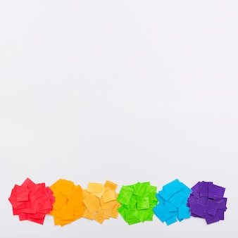 Pride day concept pieces of colourful paper