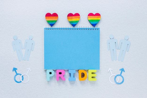 Pride inscription with rainbow hearts and gay couples icons