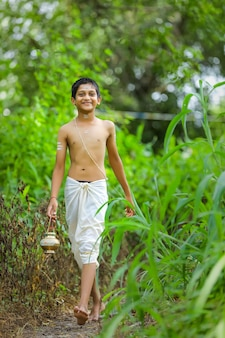 A priest child walking at forest
