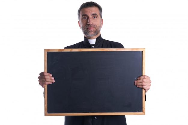 Priest holding empty blackboard copy space