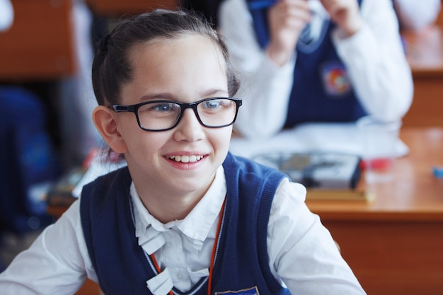 Primary school students think and perform tasks in the classroom. the concept of primary education, training and human resources. Premium Photo