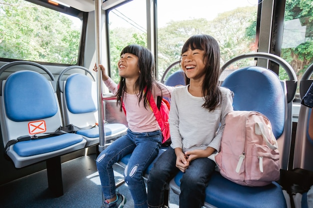 Primary student going to school by bus public transportation together