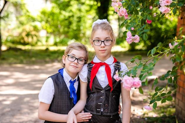 Primary students wearing school uniform.