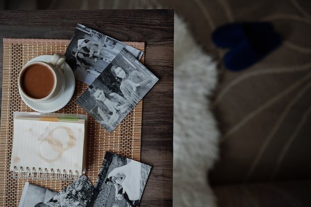 Printed photos and coffee