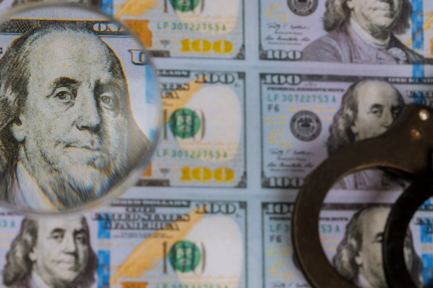 Printed us dollars banknotes, fake money currency counterfeiting for magnifying glass
