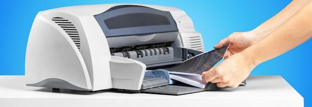 Printer copier machine on bright blue