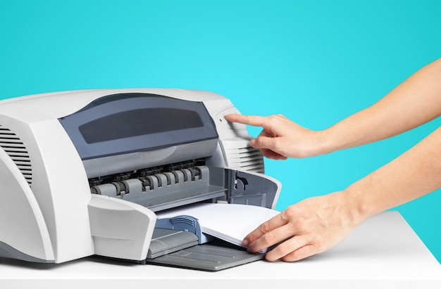 Printer copier machine on a bright blue