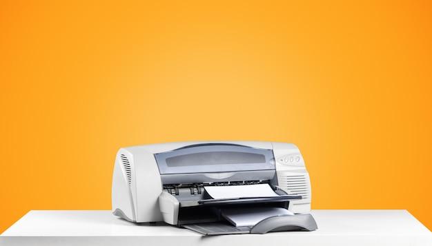 Printer copier machine on bright orange