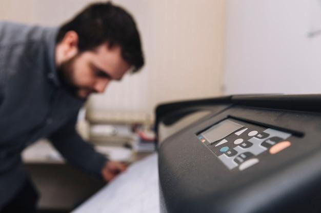 Printer near blurred architect
