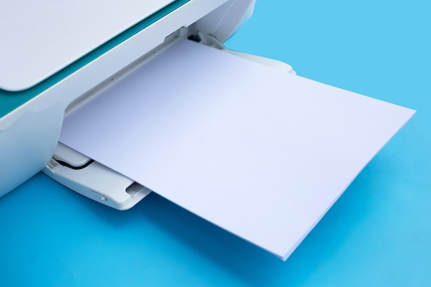 Printer and paper on blue background.