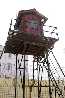 Prison tower and barbed wire fence