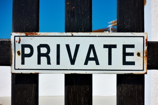 Private sign on a gate close-up