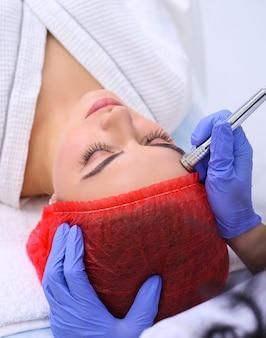 Procedure of microdermabrasion. mechanical exfoliation, diamond polishing