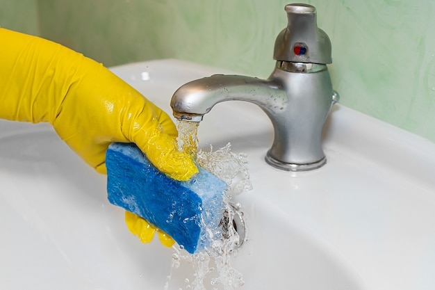 The process of cleaning the washbasin in the bathroom expensive utility bills