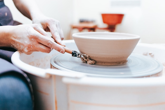 Process of creating and formation a white clay ceramic plate