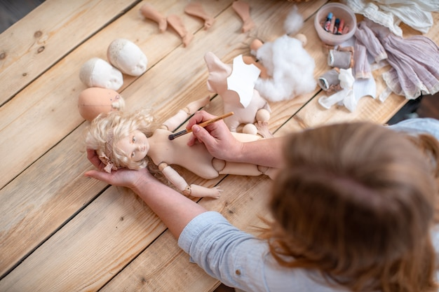 The process of creating a handmade designer doll.