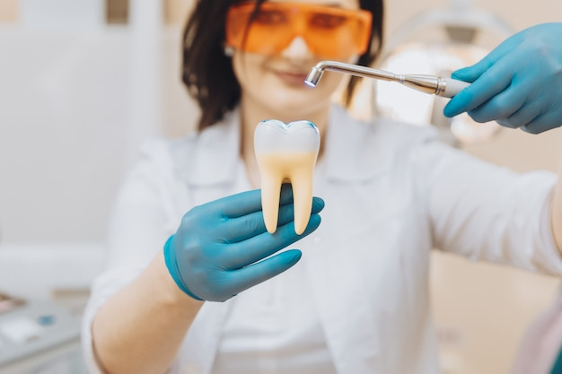 Process of filling on fake tooth.