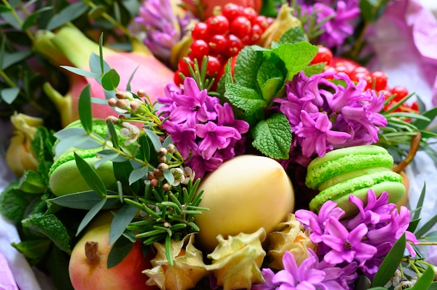 Process of forming a fruit and flower bouquet.