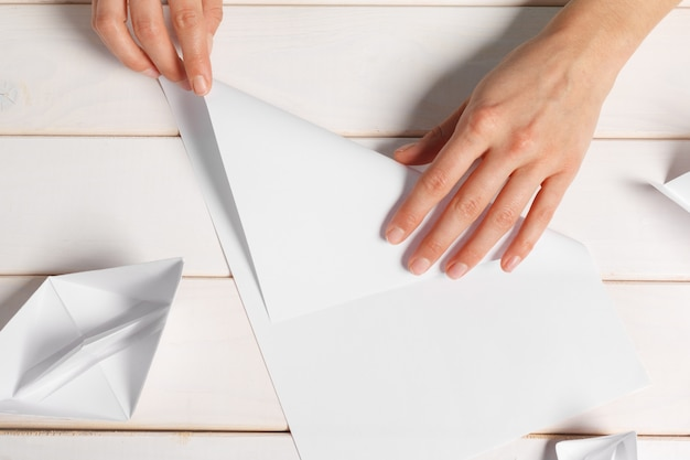 Process of handcrafting origami paper boat