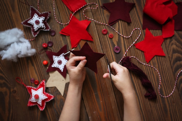 Process of handmade toys sewing for christmas