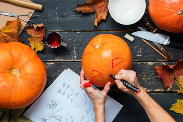 Process hands drawing marker character pumpkin