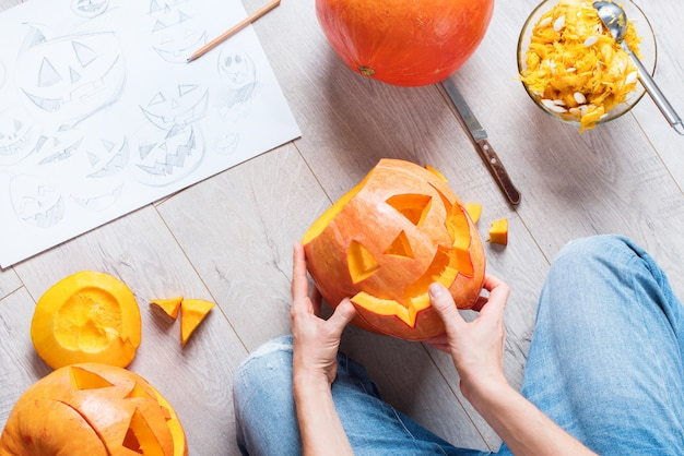 Process hands make pumpkin halloween holiday