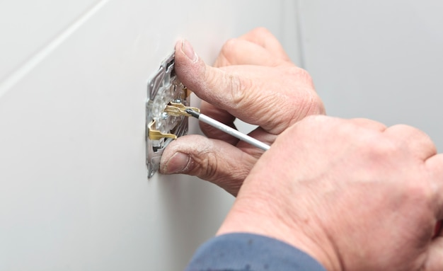 The process of installation of electrical sockets by electrician