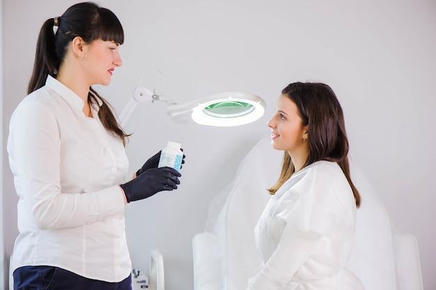 Process of legs depilation by sugar for women in beauty salon.