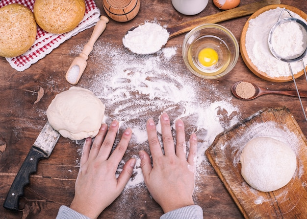 Process of making buns from a yeast dough