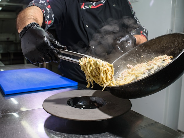 The process of making carbonara pasta for restaurant guests. tasty food.