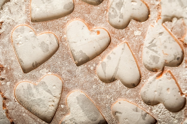 The process of making gingerbread. flat lay flour heart dough.
