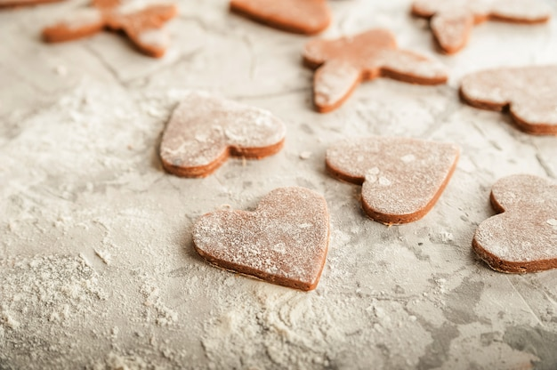 The process of making gingerbread. flat lay flour heart dough
