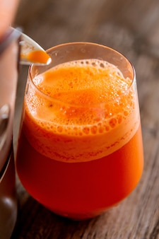 Process of making juice in a juicer, process preparation of fresh juice in juicer, carrot juice