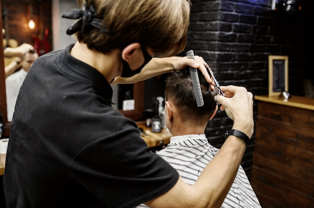 The process of men's haircuts in a stylish barbershop