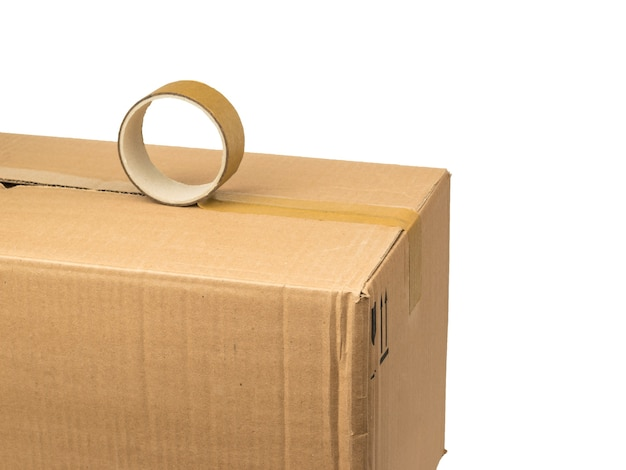 The process of packing a cardboard box using duct tape isolated on a white surface