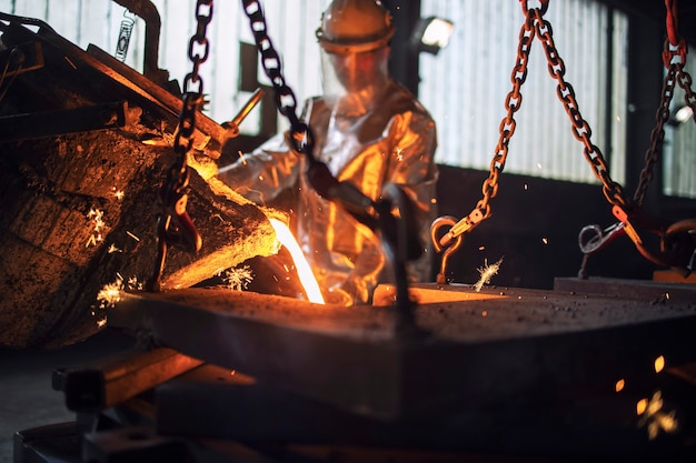 Process of pouring hot molten steel in foundry, metallurgy process and steel production.
