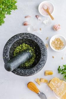 Process of preparation traditional italian pesto genovese sauce