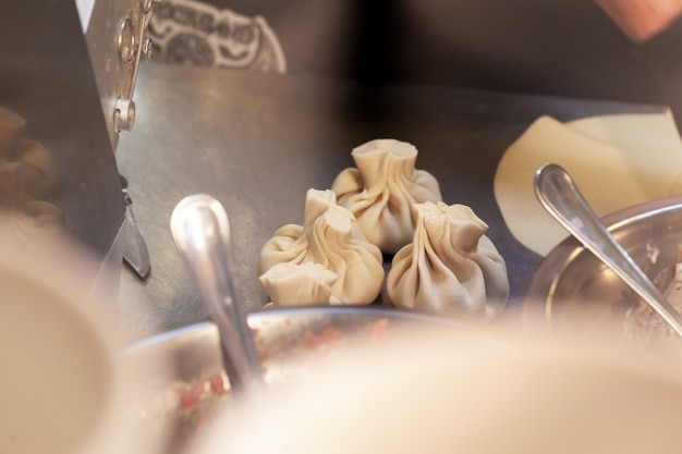Process of preparing khinkali in a cafe close up
