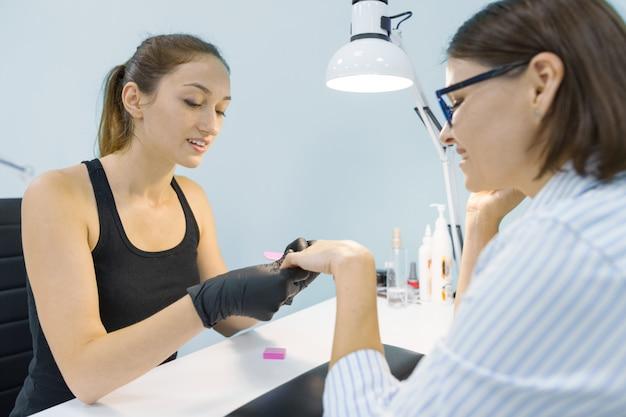 Process of professional manicure.
