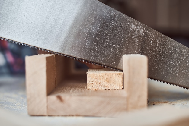 Process of sawing wooden board. concept of diy woodwork and furniture making
