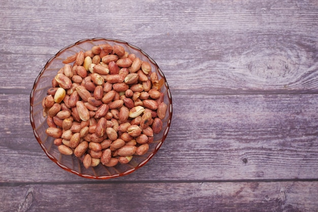 Processed pea nuts in a bowl on table top down