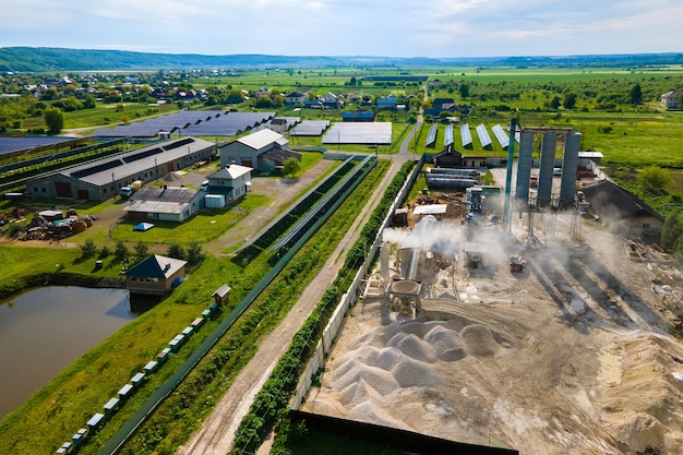 Processing factory at mining site producing cement construction materials.