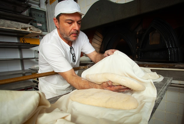Production of baked bread with a wood oven in a bakery