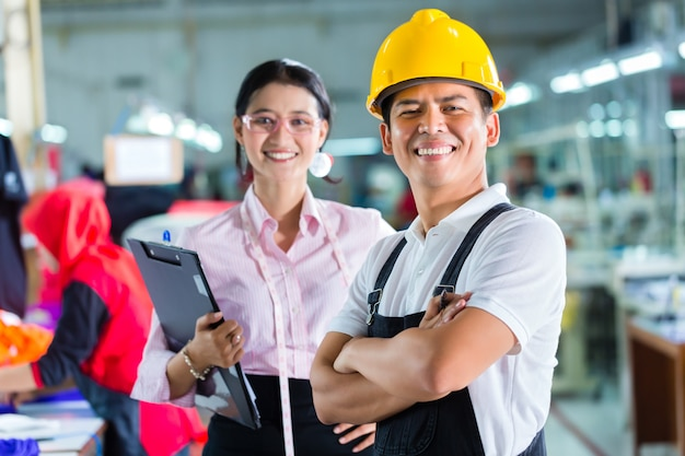 Production manager and designer in asian factory