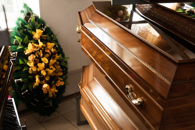 Production and manufacture of funeral goods. coffins and wreaths close up