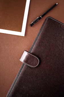 Productivity work and corporate lifestyle concept  vintage business briefcase on the office table desk flatlay background